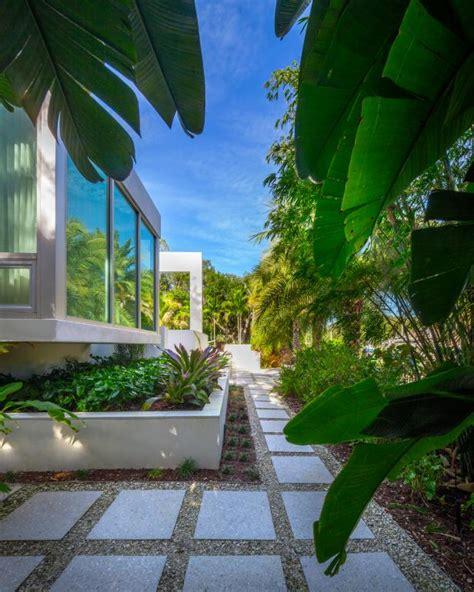 gravel  paver walkway view  tropical garden hgtv