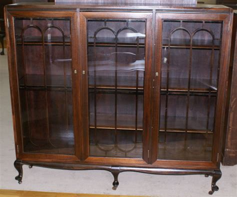 Dining Room Chairs With Rollers petite walnut antique triple door bookcase