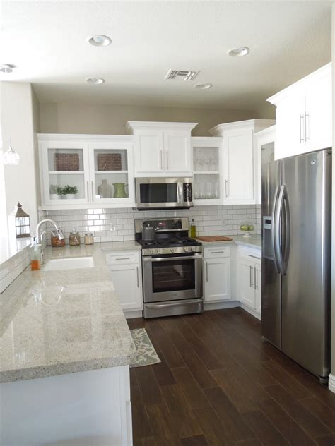 floor and decor granite countertops next house white cabinets white backsplash gray