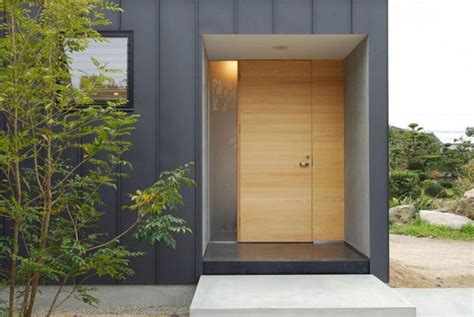 modern house front door designs modern exterior door and vertical metal siding chukuzen house by design nico japan