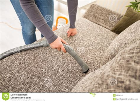 Vacuum Cleaner Untuk Sofa vacuuming sofa in living room stock photo image 68232222