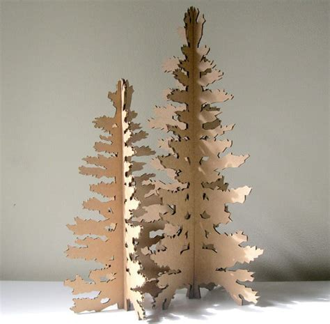 eco laser cut cardboard christmas tree by seequin