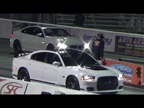 dodge m4 2015 bmw m4 vs 6 4l charger 392 srt8 1 4 mile drag race