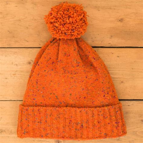 bobble wool knitting merino wool knitted bobble hat by oubas knitwear