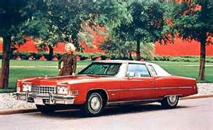 Above 1973 cadillac eldorado coupe in dynasty red with white padded