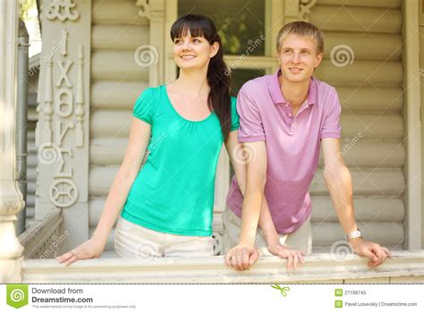 terrace house couple couple leaning on terrace of house royalty free stock