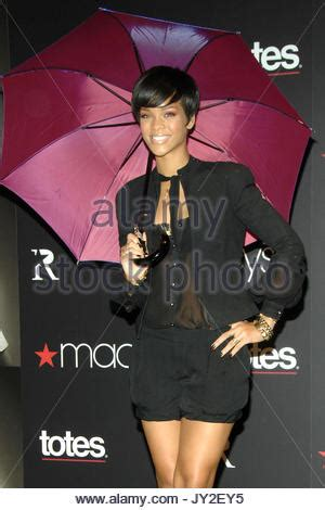 Rihannas Umbrella Collection by Macy S And Totes Launch Rihanna Umbrella Collection Stock
