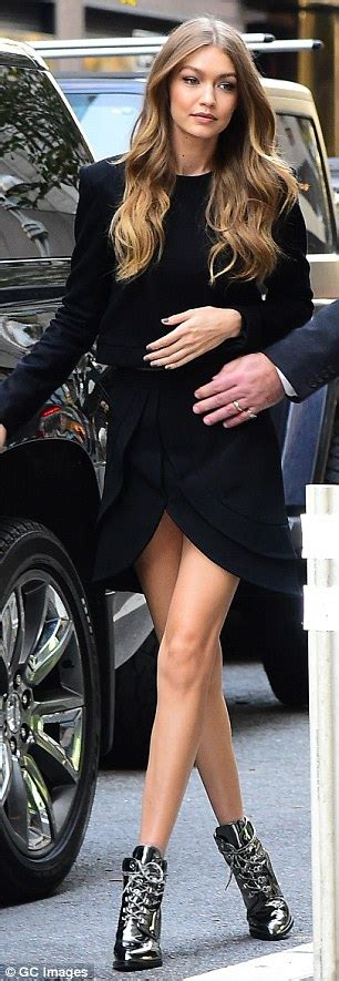 Were The Same But One Wears A Skirt by Gigi Hadid Struts Around In Signature Silver Shoe With