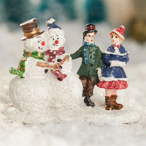 miniature snowman and children figurine christmas