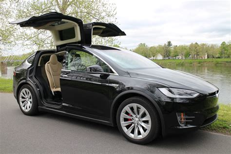 is tesla electric so what happened to tesla model x electric suv sales anyway