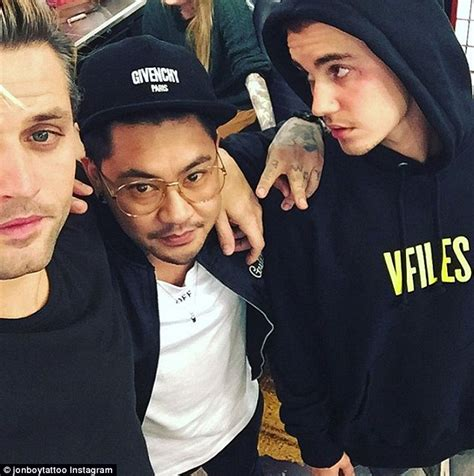 cross tattoo under eye meaning justin bieber s artist reveals meaning