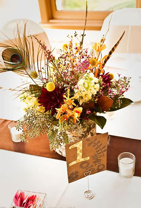 fall centerpieces with feathers fall wedding centerpieces wedding flowers wedding ideas brides com brides com