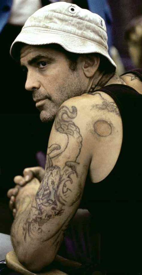 george clooney tribal tattoo george clooney see photos of the iconic actor