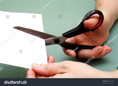 How To Make Scissors Out Of Paper - is cutting paper with scissors stock photo