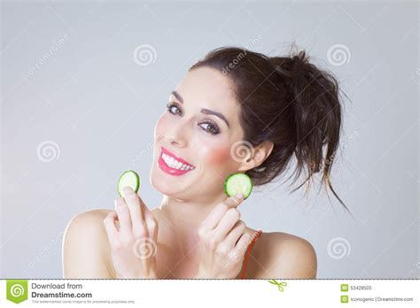 girl with cucumber girl with cucumber slices stock photo image 53428503