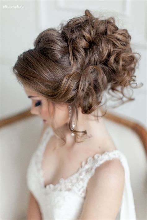 bridal hairstyles let down venician textured curls woven into a high messy bun