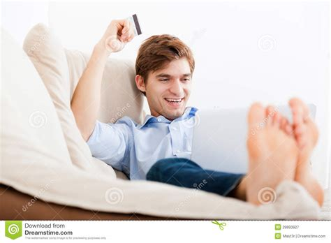 couch shopping online man shopping online stock image image of happy looking