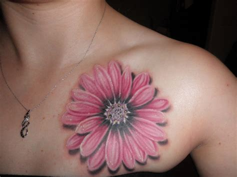 daisy flower tattoo on collarbone