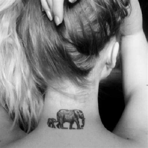 mom and baby elephant tattoo and baby elephant