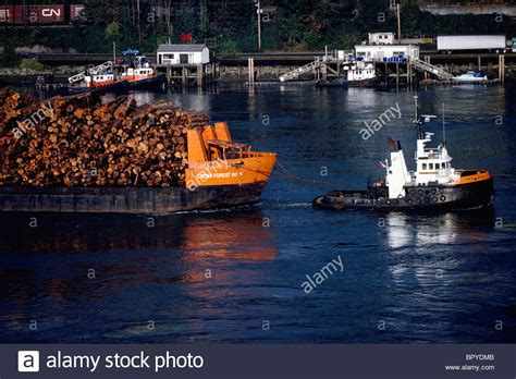 tug boats for sale bc canada tugboat towing a barge full of logs on fraser river