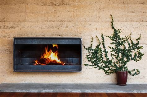 Rammed Earth Fireplace by Aqueduct House Architectureau