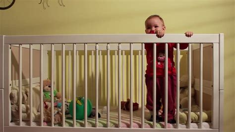 Baby Cries In Crib Baby In Crib Waking Up Looking Around Stock Footage