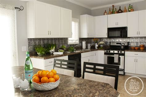 how to put up backsplash in kitchen planning to put up this faux tin tile backsplash up in my