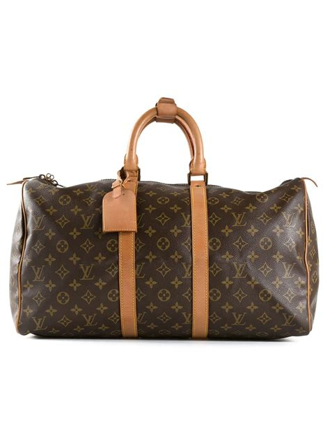 louis vuitton monogram  keepall bag  brown lyst