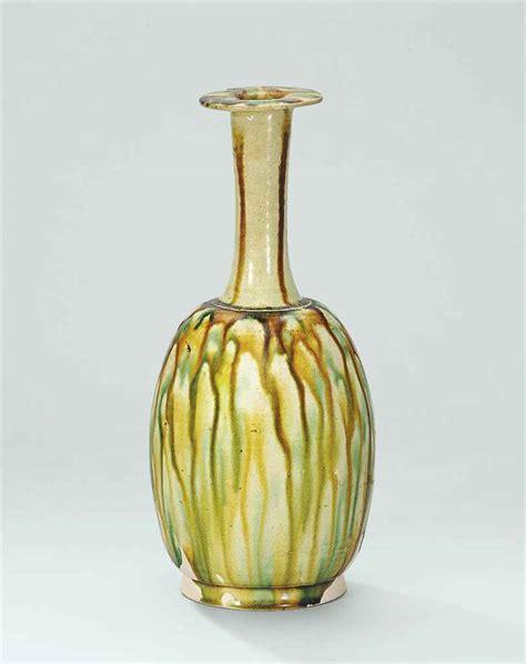 Tang Dynasty Vase by A Sancai Glazed Bottle Vase Tang Dynasty 618 907 Christie S