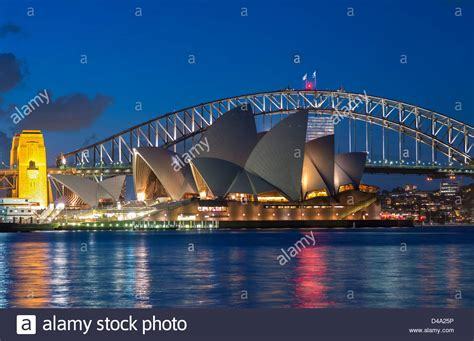houses to buy in sydney australia view sydney opera house and harbour bridge at night in australia stock photo royalty