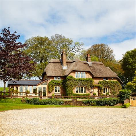 houses in dorset to buy wander through this beautiful thatched cottage in dorset housetohome co uk
