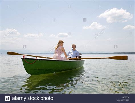 boat rowing images woman and man rowing boat on lake stock photo royalty