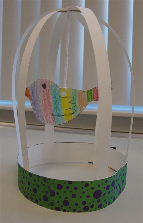 paper bird cage craft paper scissors glue bird cage sculptures
