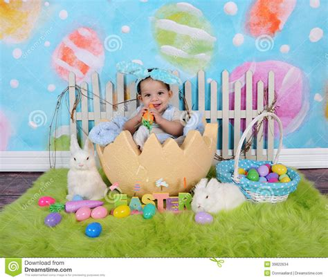 easter time avarde look hairstles adorable african baby boy sitting in giant easter egg