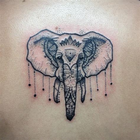 elephant skull tattoo geometric skull on left forearm by daniel rozo