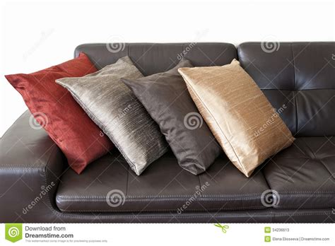cushions for dark brown sofa cushions on leather sofa stock photos image 34236613