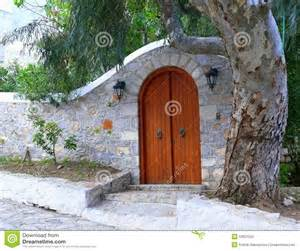Spanish Courtyard House Plans arched stone courtyard entry wall with arched wooden door