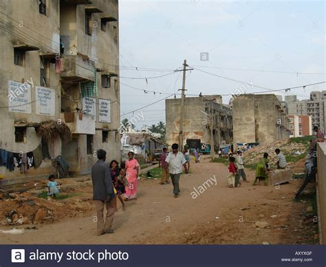 buying houses in india houses in bad shape with indian characters near to a big slum india stock photo