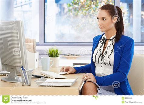 Office Worker At Desk Pretty Office Worker At Desk Stock Photo Image 26384628