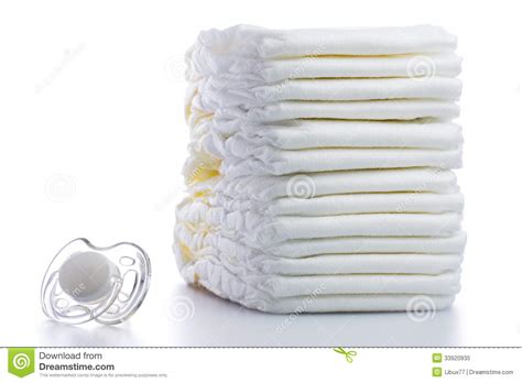 Disposable Diapers X S M L stack of nappies and pacifier stock image image 33920935