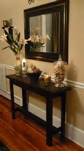 Entry Way Table Decor by Maybe When The Kids Grow Up But The Chair Rail Is A Nice