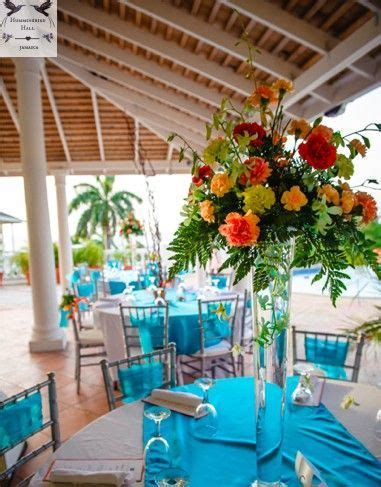 Tropical floral trumpet vase wedding centerpieces at a