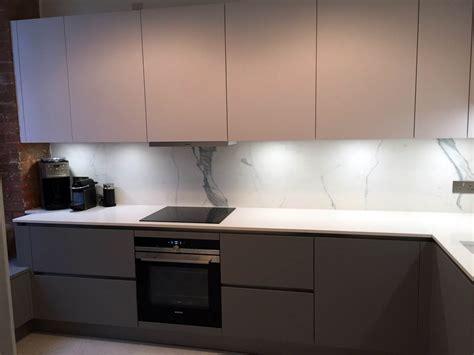 Grey Handleless Kitchen matt pearl grey pearl white handleless tower bridge