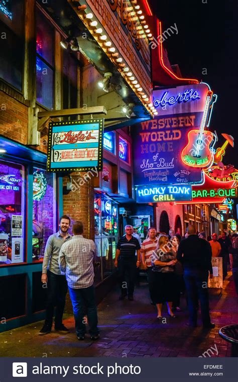 nashville light district nighttime neon lights up lower broadway for tourists