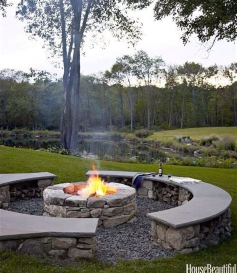 benches around fire pit love this put gravel around fire pit withstump chairs or