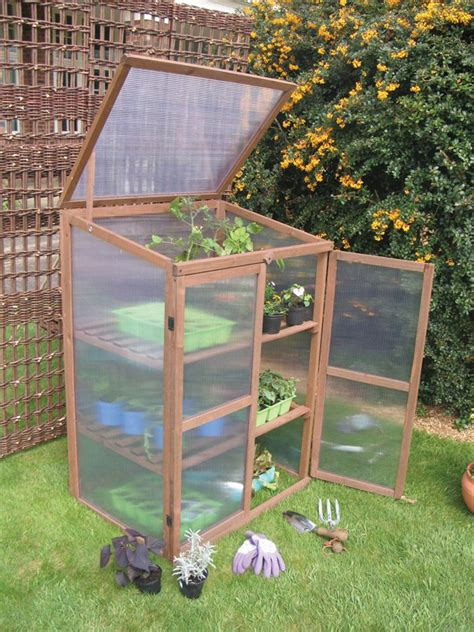 wooden growhouse small greenhouse garden pinterest