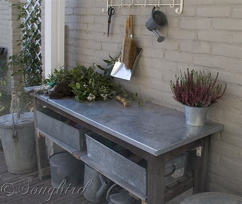 galvanized potting bench vintage coat rack finishes a garden work area with a work