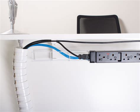 desk with cable management pathfinder