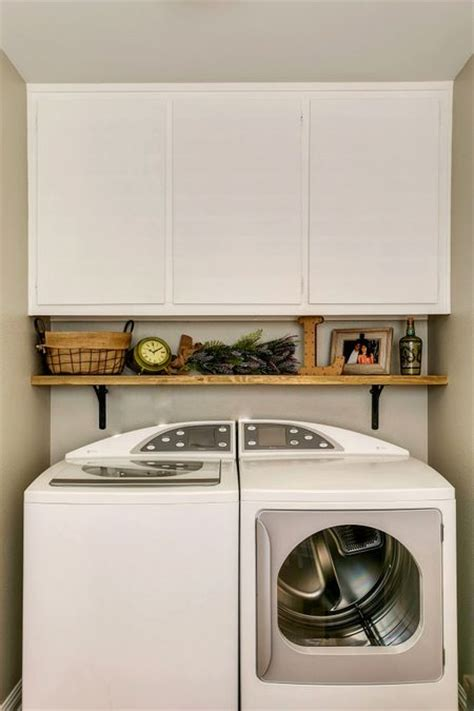 rustic wood shelf above washer and dryer laundry and
