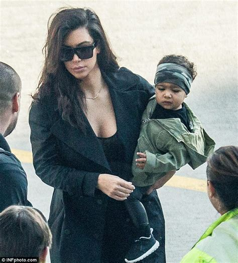 Kim kardashian and kanye west s daughter north wears camouflage bandana daily mail online